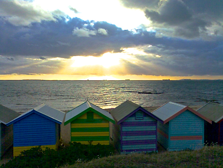 Sun streaming over bathing boxes