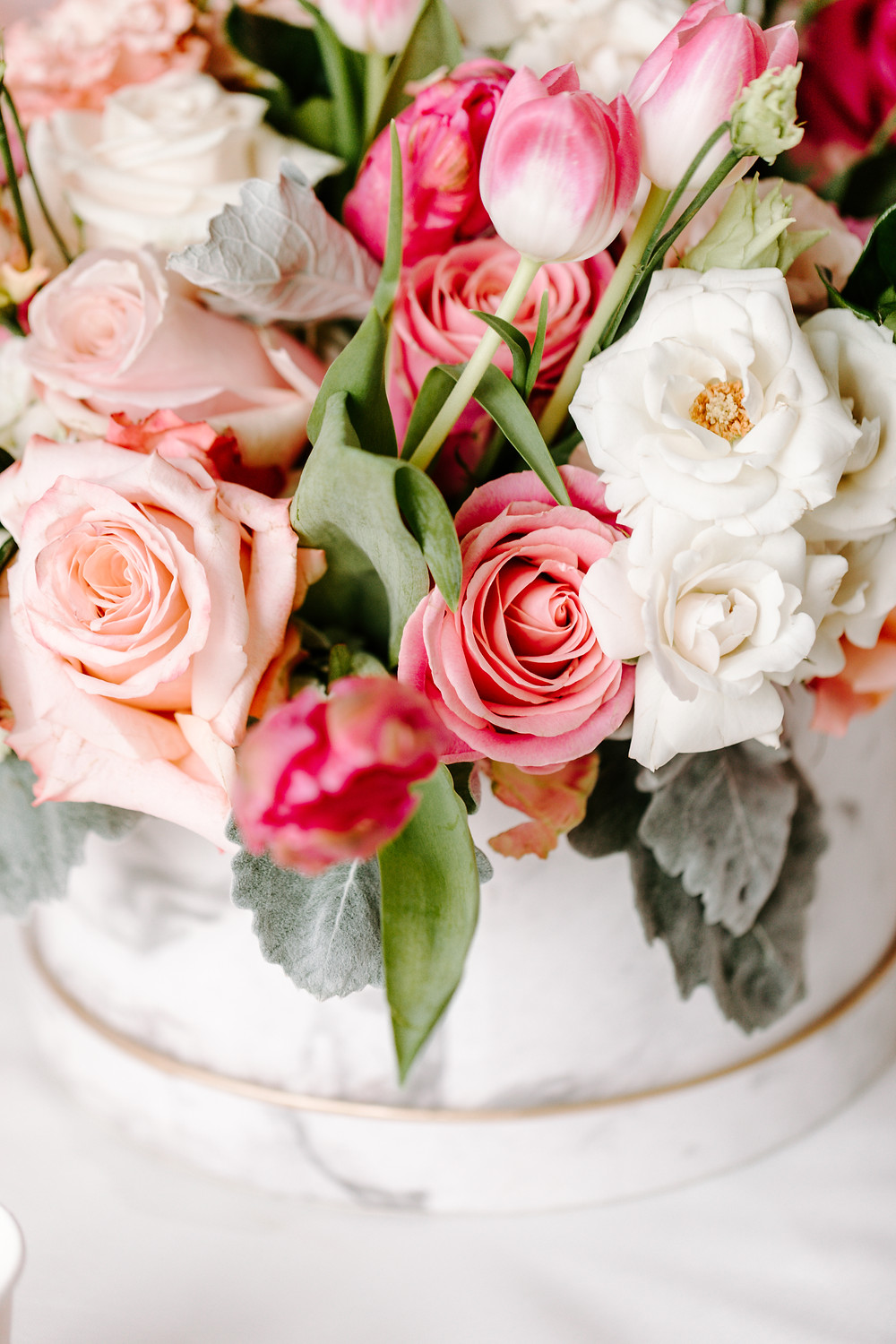 Close up of flowers: garden roses, tulips, stock, lisianthus