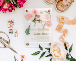 Girl's first birthday invitation with pressed flowers and raised font