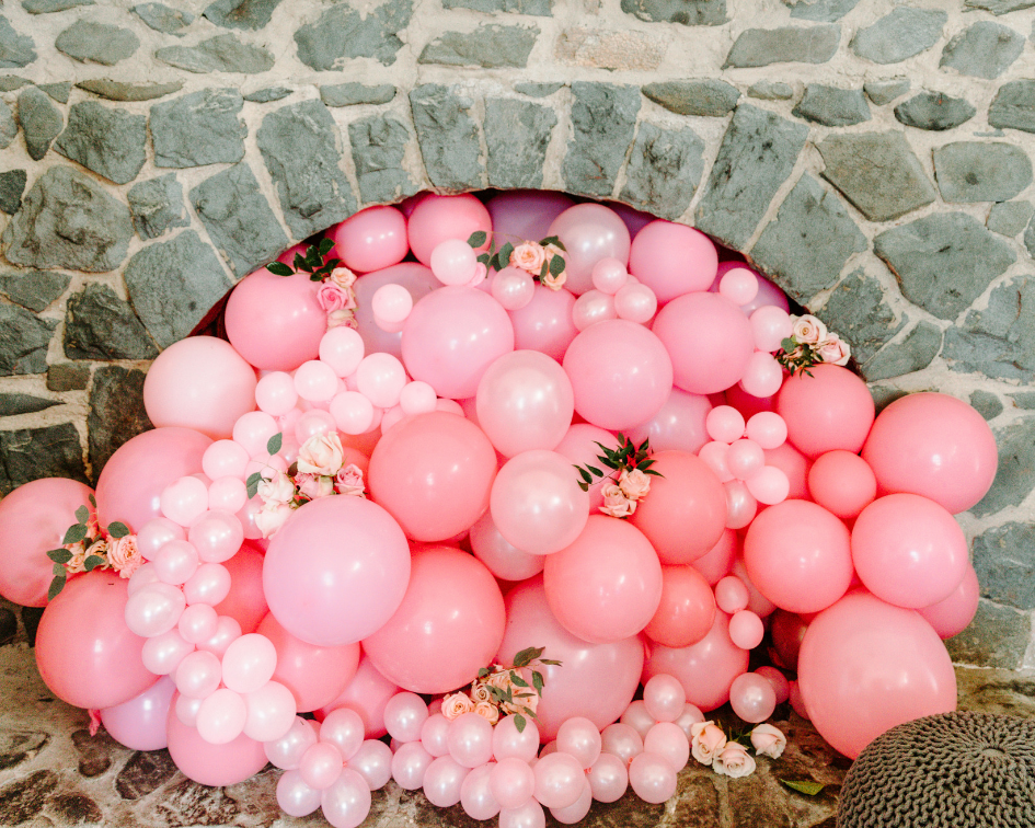 Pink balloon installation in fireplace at Carroll Baldwin Hall