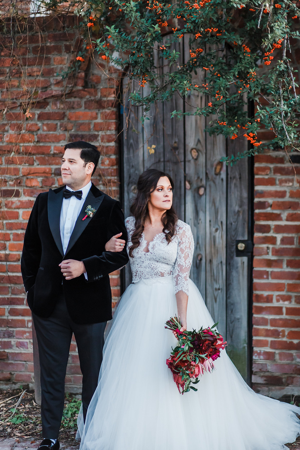 Rustic photoshoot with wooden door and bridal bouquet