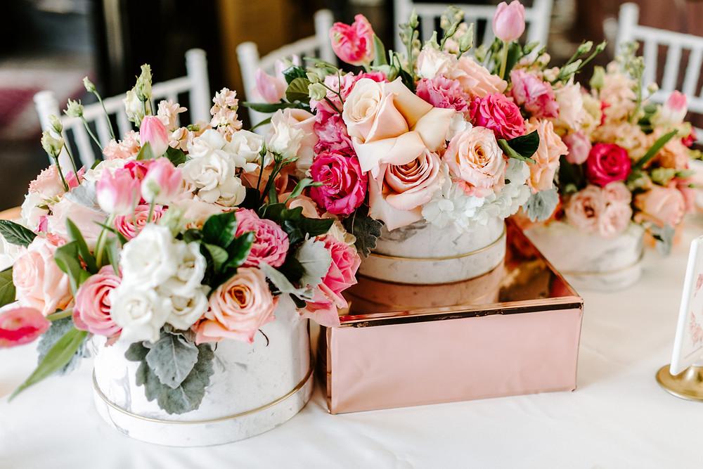 Garden roses, eucalyptus, tulips floral design centerpieces