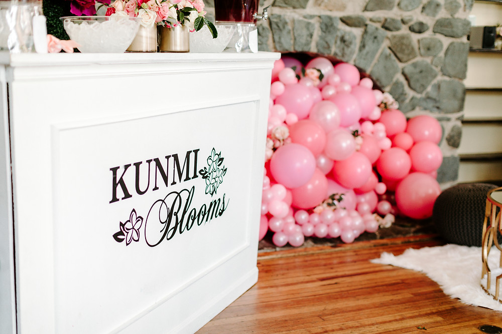 Pink balloon installation at girl's first birthday event design