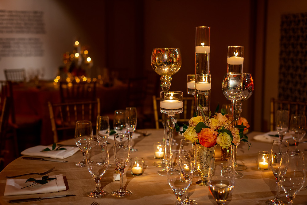 Floral design of guest tables at The National Museum of Women in the Arts wedding venue