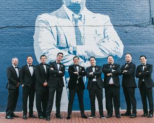 Groomsmen in front of Washington D.C. mural