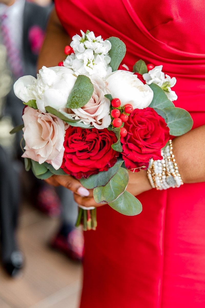 Red, white, and light pink bridesmaids bouquets