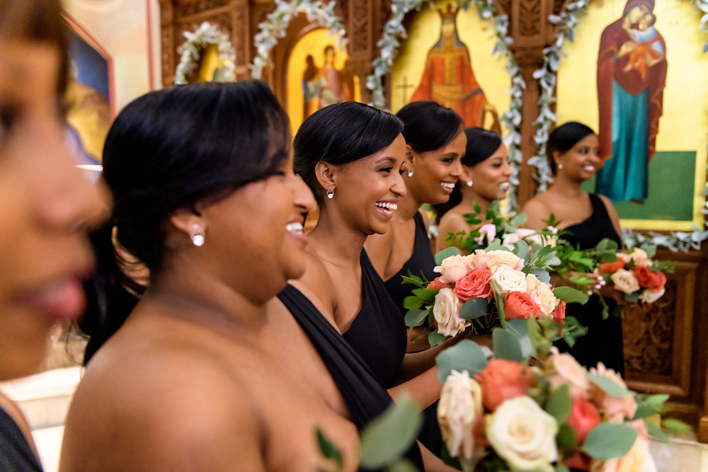 Bridesmaids celebrating at Saint Katherine Greek Orthodox Church