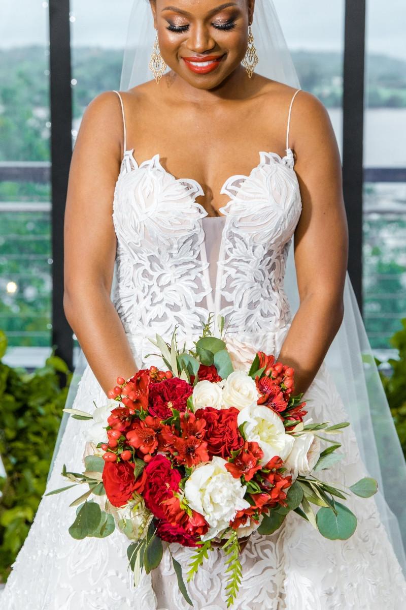Bridge holding bridal bouquet at District Winery Wedding DC venue