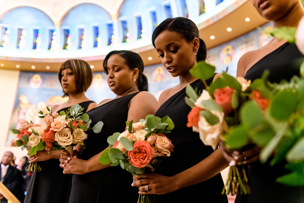 Bridesmaids with garden rose bouquets at the Saint Katherine Greek Orthodox Church