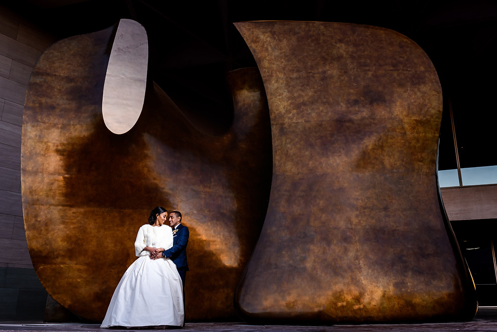 The couple embracing at The National Museum of Women in the Arts Washington DC wedding venue