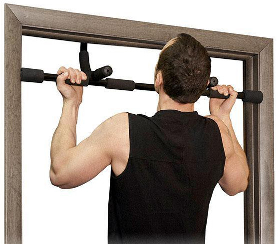 Man doing chins on doorway pull up bar