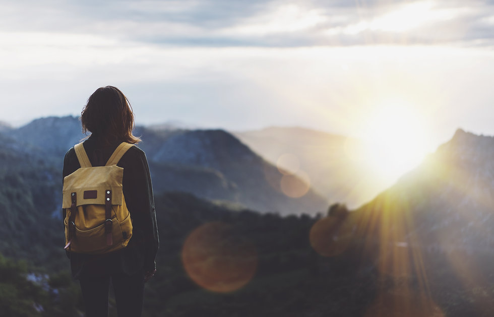 Hipster young girl with backpack enjoyin