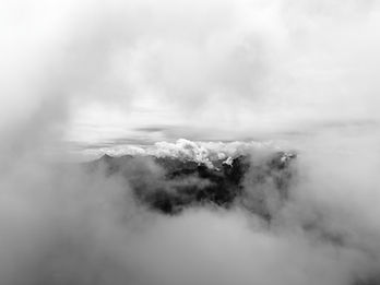 Peeping at Mountains Through the Clouds.
