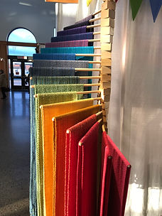Rainbow of handwoven scarves