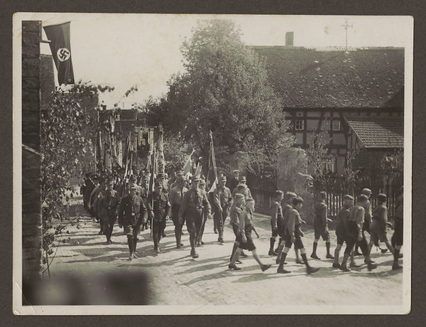 SA members and Hitler Youth march down t