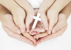 Generational-hands-holding-cross_edited.