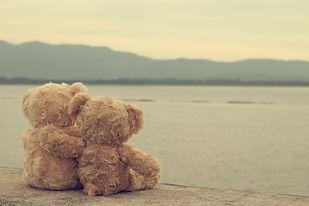 Two teddy bears hugging. vintage tone..j