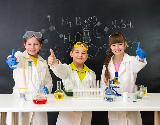 three little students on chemistry lesso