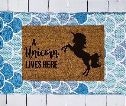 A unicorn lives here doormat