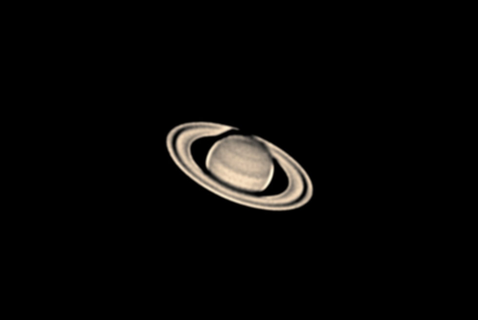 Saturn taken with an amateur telescope from a city balcony.
