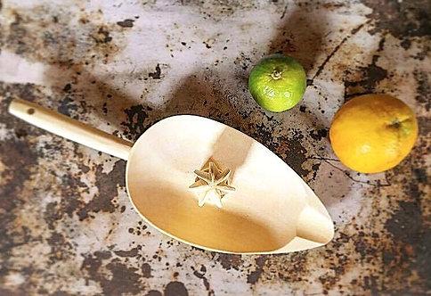 Le presse agrumes en bois de citronnier