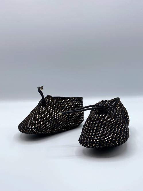 Les chaussons Bébé noir et or