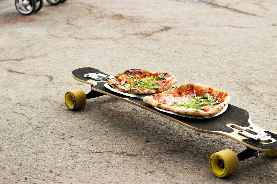 pizzas on skateboard