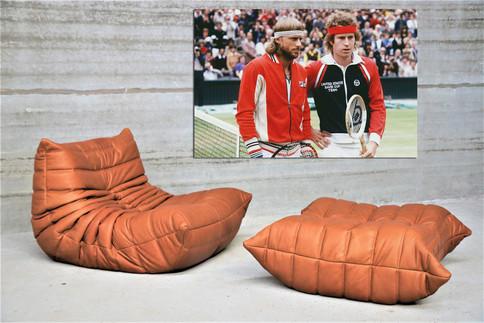 Cognac Ligne Roset Fireside and poef lounge chair + Nr 59 Wimbeldon Bjorn Borg & John McEnroe Final 1980 alu print