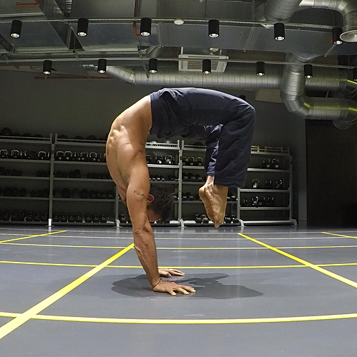 Alex Nino - Strength, mobility and handstand coach - one of our top trainers