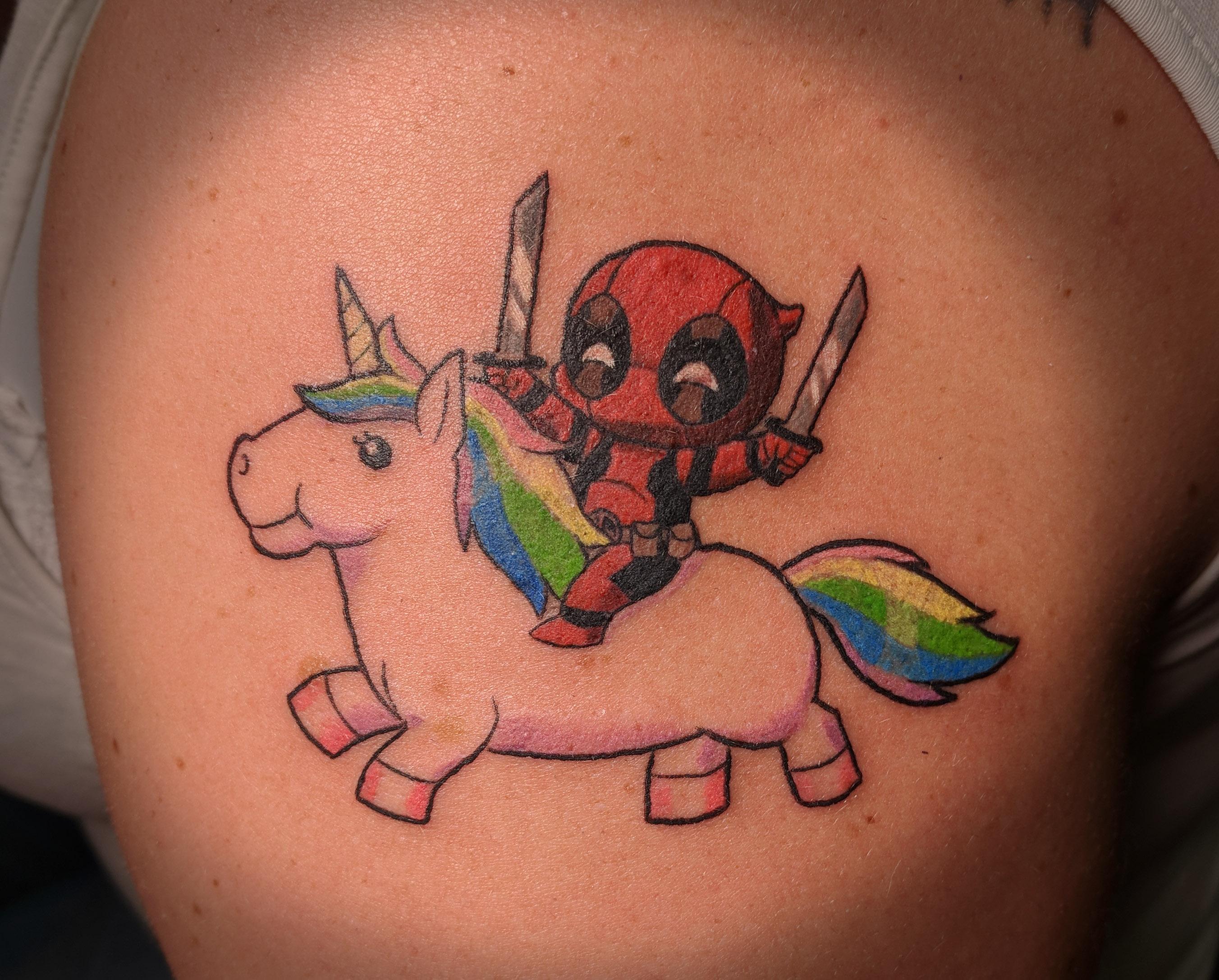 Deadpool riding a unicorn