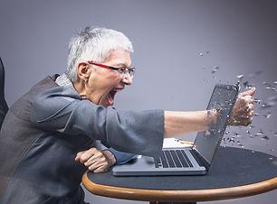 Crazy enraged senior business woman punc