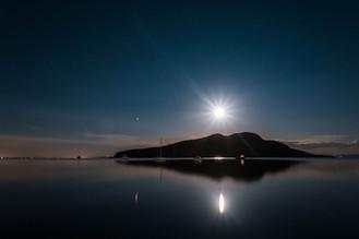 Full harvest moon and mars reflecting on Lamlash Bay