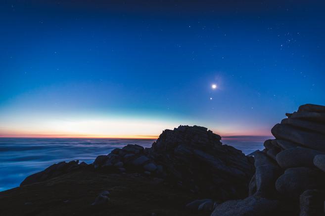 The moon and Venus above Caisteal Abhail