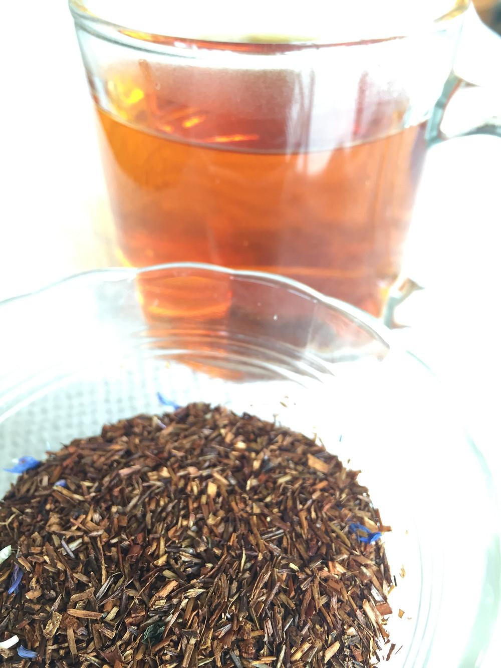 Rooibos tea leaves and cup of tea