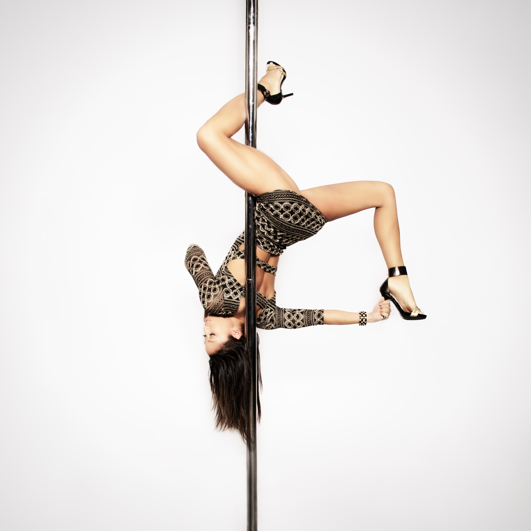 Nicole ThePole in inside leg hang