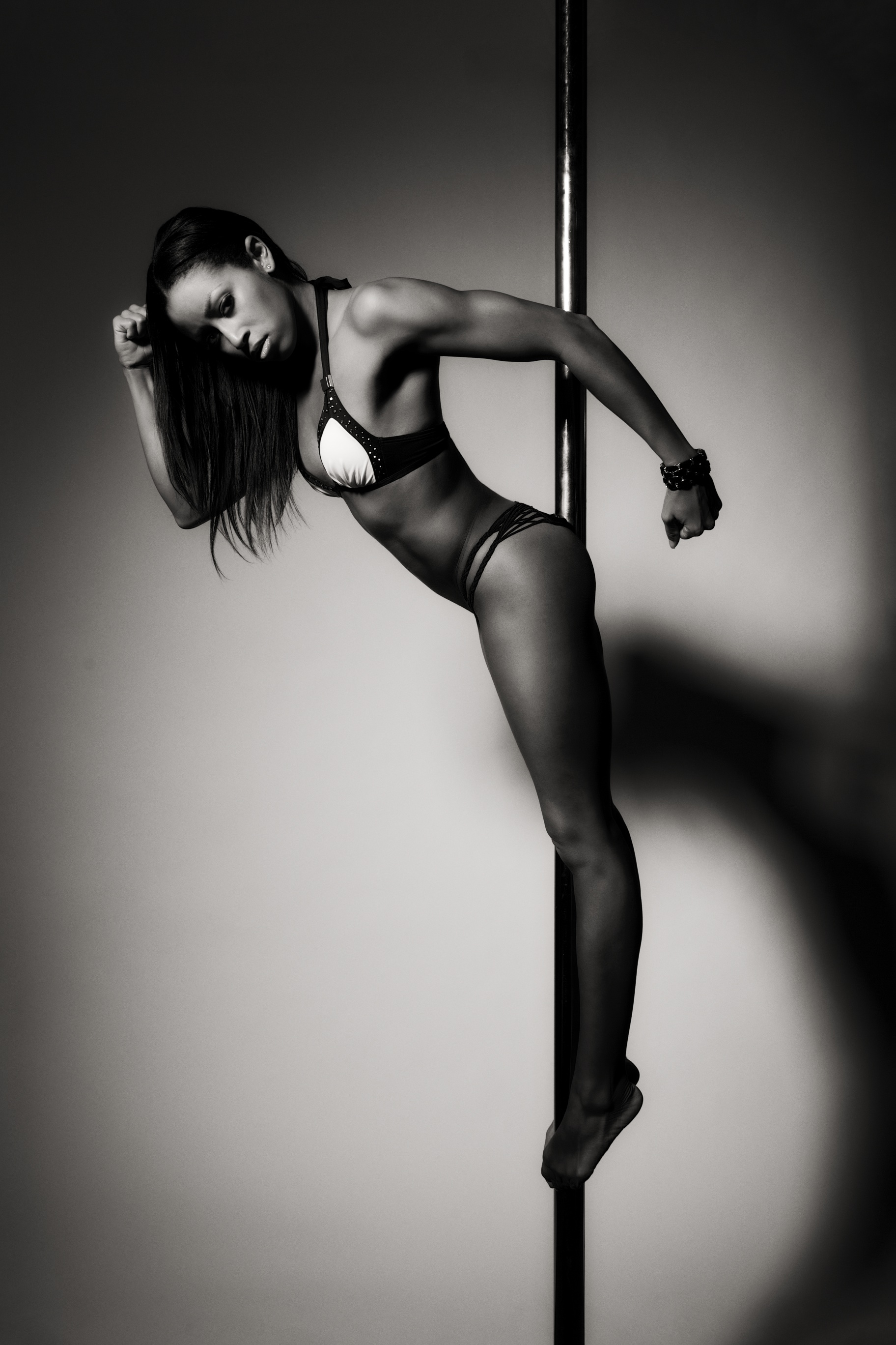 Nicole ThePole in illusionist pose