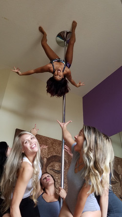 nicole thepole standing on ceiling after pole party