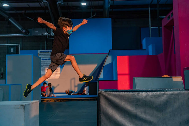 Kid doing parkour at freedom in motion parkour gym