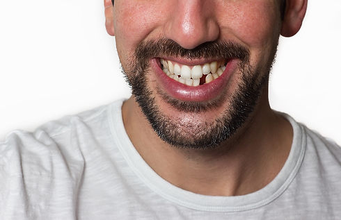 Close up on a man smiling while he is mi