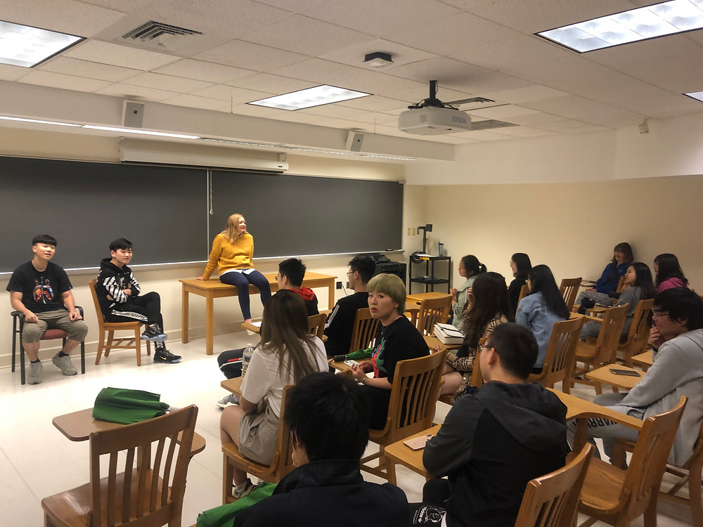 SAs Jalilah, Kobi, and Sam took students to get a taste of university life!  Former student Chester Huang speaks to the class.