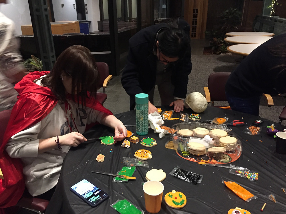 Students Haylee Yang and Matt Guo try their hands at cookie decoration