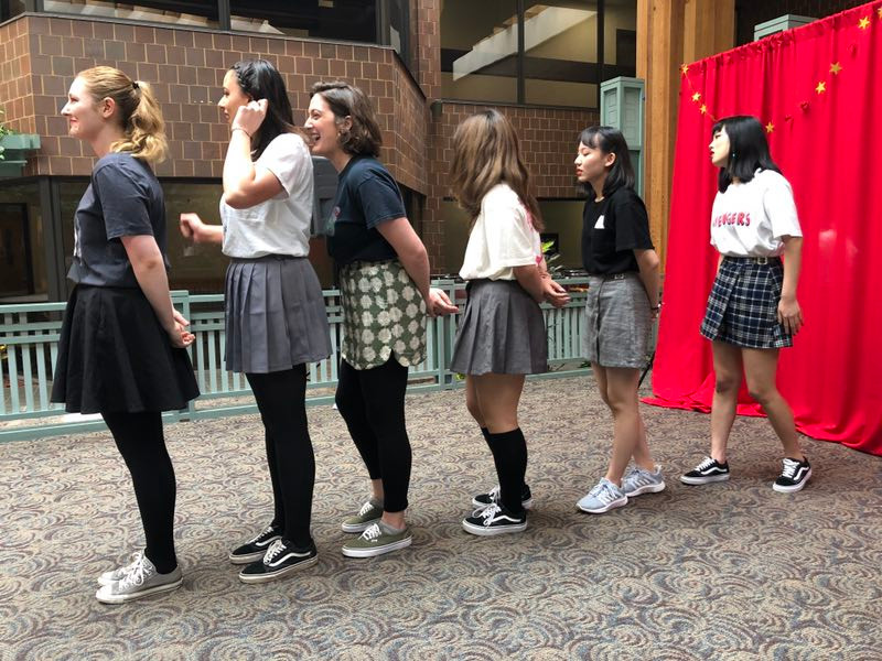 Staff members Ashley Sauseman, Jalilah Gonsalves, Leah Boccaccio and students April Bu, Stella Chen, and Amber Guan perform their dance