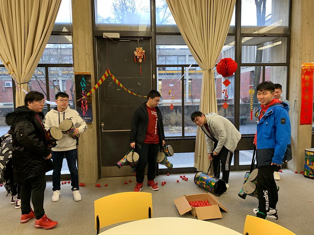 Students Chris Ye, James Zhang, Jeremy Liu, Nick Wan, Yiming Chen help set up for the performance