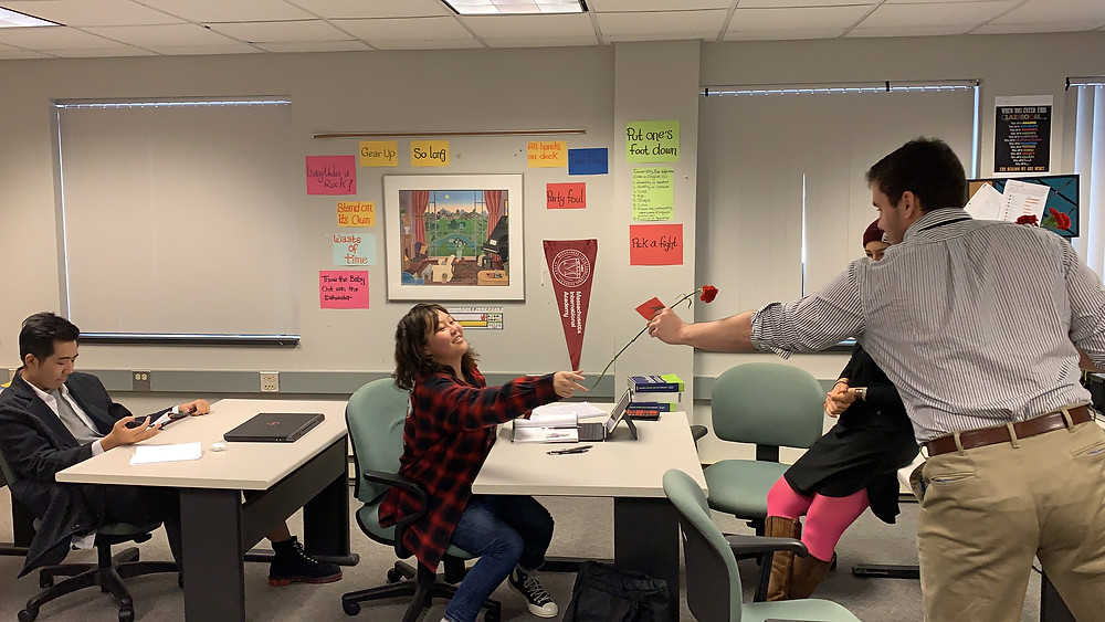 Student Kasa Ni receives a Valentine's Day rose purchased for her by a classmate