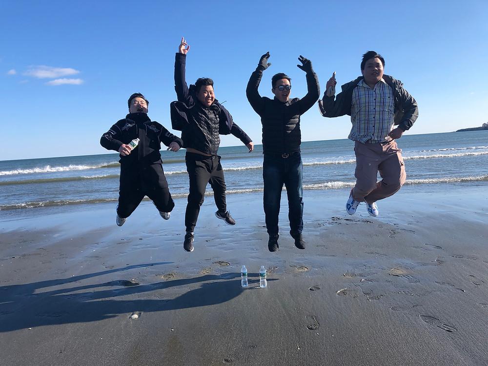 Students James Zhang, Huibin Wang, Eason Xu, and Ken Zhou jump for joy