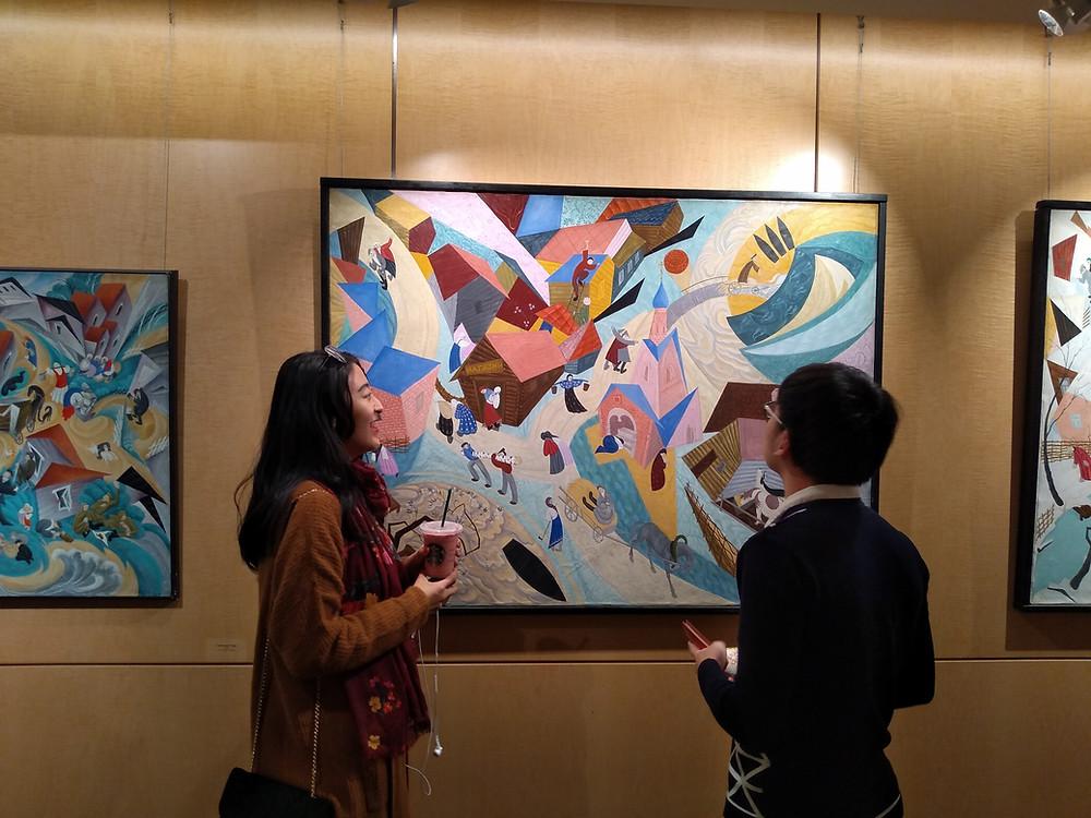 Students Lucky Shitong Yan and Chris Chenxu Ye appreciating the artwork