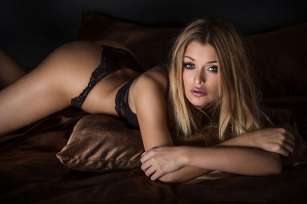 bigstock-Sexy-Blonde-Woman-Posing-In-Li-