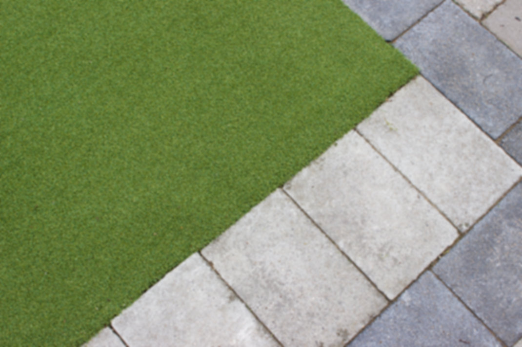 Edge of Putting Green boardered by Garden Paving