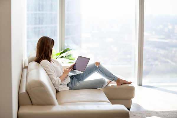 Relaxed woman using laptop in luxury hom