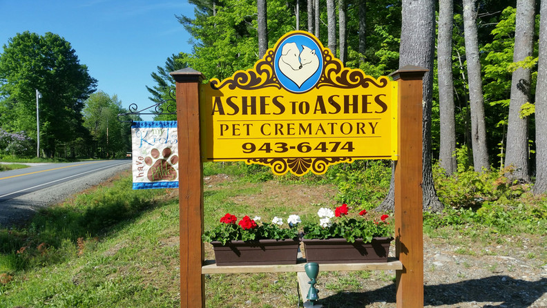 The big yellow sign at Ashes to Ahes Pet Crematory
